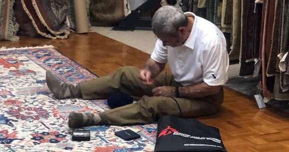 Man restoring the rug